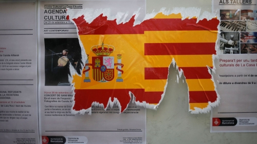 a-damaged-sticker-of-the-spanish-flag-is-seen-on-a-wall-ahead-of-the-banned-october-1-independence-referendum-in-barcelona_5953268.jpg